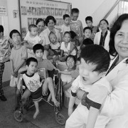 Obstetrician Nguyen Thi Ngoc Phuong with a group of disabled children, most victims of Agent Orange